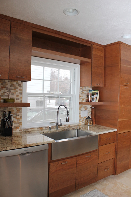 Kitchen Window Surrounded By Cherry Cabinets