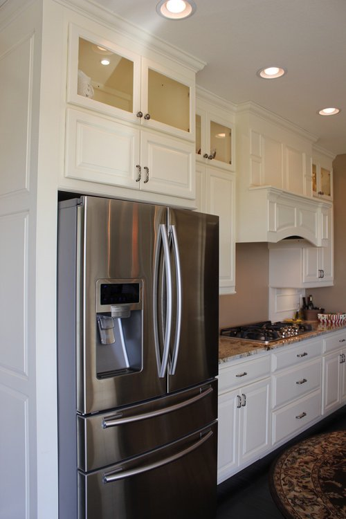 Appliances Framed with White Painted Birch Cabinets