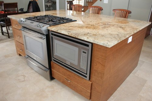 Kitchen Appliances Surrounded by Custom Cherry Cabinets